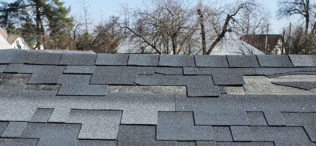 damaged shingles on a roof